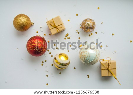 red christmas balls and boxes on white background #1256676538