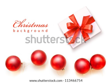 Red Christmas balls and white gift with red ribbon bow, isolated on white background