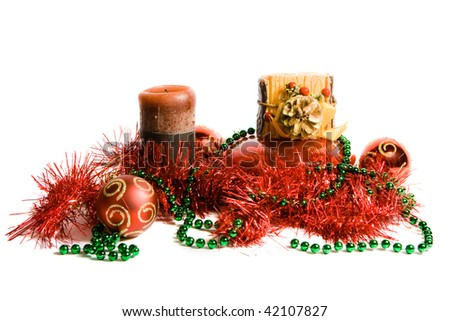 Red christmas balls, candles and red tinsel