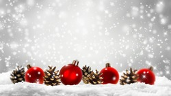 red christmas balls, cones, snow, festive xmas decoration, abstract empty shiny winter background with snowflakes, advent season concept
