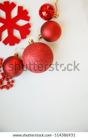 red christmas balls, decorations, red beards and red snowflake on white background, top view, selective focus #514386931