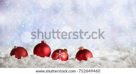 Red Christmas balls on abstract cold winter background with snow - Shutterstock ID 752649460