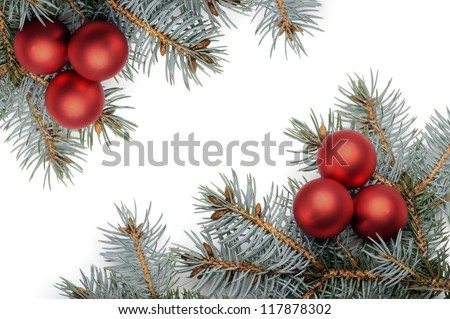 red christmas balls on pine branch, isolated on white
