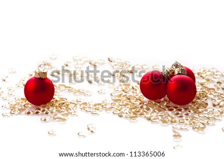 Red Christmas balls on the color background .