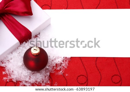 Red christmas balls with snow and gift