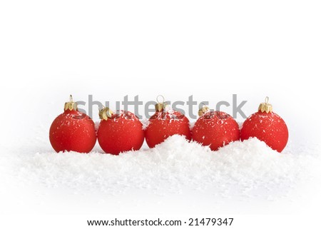Red christmas balls with snow on white