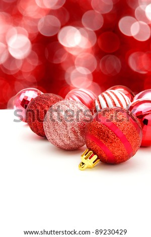 Red Christmas bauble arrangement with abstract twinkling light background