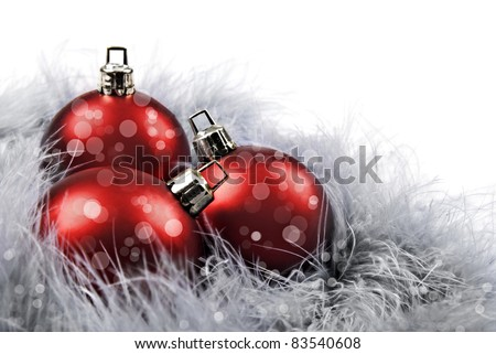 Red christmas baubles on a white background with space for text