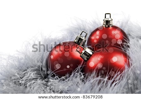 Red christmas baubles on white background