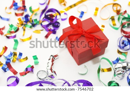 Red Christmas box whit colorful confetti