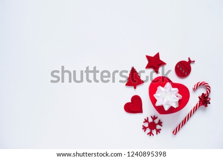 Red Christmas decorations and sweets on the white wooden background. Space for a text. Top view. Flat lay. #1240895398