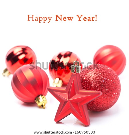 red Christmas decorations - the star and balls, isolated on white