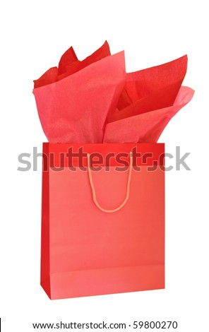 Red Christmas gift bag with tissue paper isolated on white background