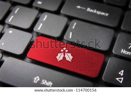 Red Christmas key with mistletoe icon on laptop keyboard. Included clipping path, so you can easily edit it.