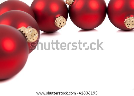 Red Christmas ornaments/baubles on a white background with copy space