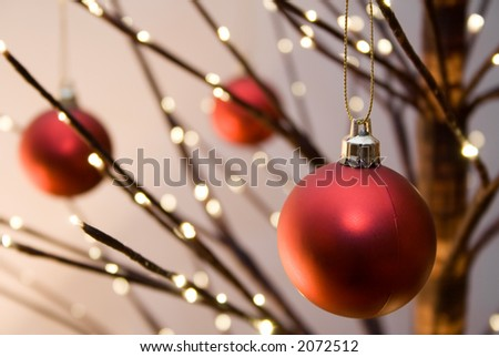 Red christmas ornaments hanging from christmas tree