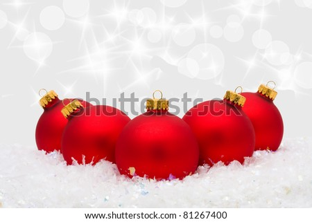 Red Christmas ornaments on snow with a silver background, Christmas Ornaments