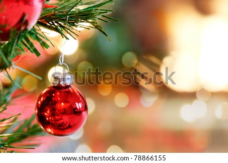Red Christmas Tree bauble by the fireplace