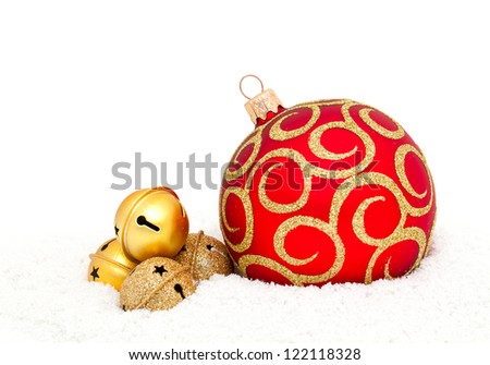 Red Chritsmas Ball and golden bells on snow