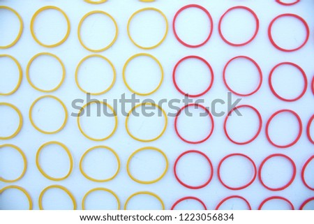 Red circle and yellow circle Placed on a wooden table. #1223056834