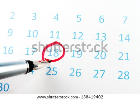 Red circle marked on a calendar with a pen