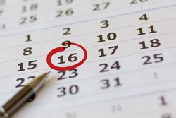 Red circle marked with pen on a calendar sheet