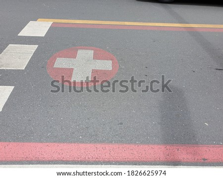 Red circle with a plus sign in the middle of the road indicates that it is an ambulance lane. Сток-фото ©