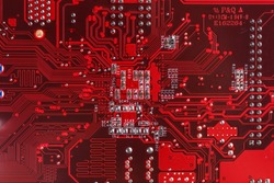 Red circuit board background of computer motherboard