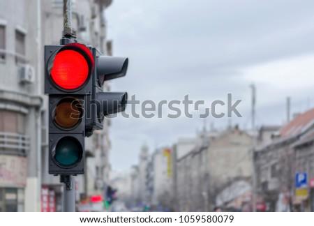 Red city urban semaphore light with blury background - Shutterstock ID 1059580079
