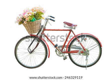 red classic bike with flower in basket isolate on white background