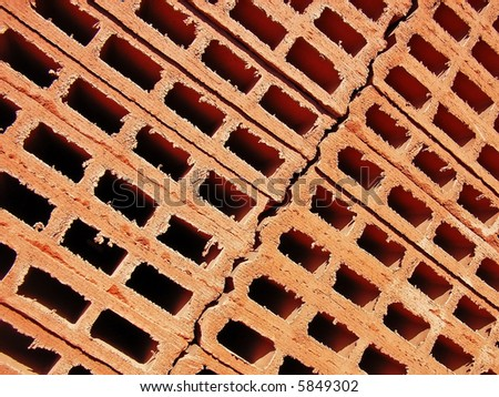 Red clay bricks stacked in a construction site