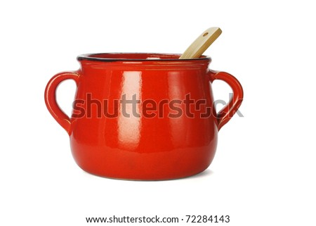 Red clay pot with wooden ladle on white background