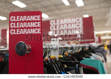 Red clearance sale sign in retain store