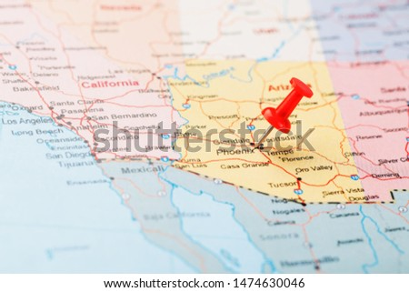 Red clerical needle on a map of the USA, Arizona and the capital Phoenix. Close up map of orizona with red tack #1474630046