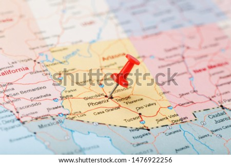 Red clerical needle on a map of the USA, Arizona and the capital Phoenix. Close up map of orizona with red tack #1476922256