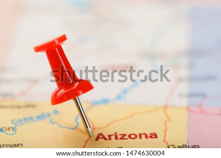 Red clerical needle on a map of USA, Arizona and the capital Phoenix. Closeup Map Arizona with Red Tack #1474630004