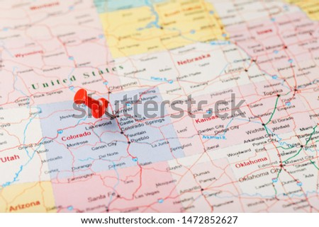 Red clerical needle on a map of USA, Colorado and the capital Denver. Closeup Map Colorado with Red Tack, United States map pin #1472852627