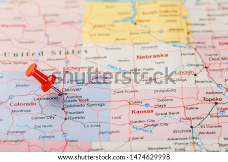 Red clerical needle on a map of USA, Colorado and the capital Denver. Closeup Map Colorado with Red Tack, United States map pin #1474629998