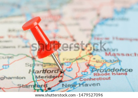 Red clerical needle on a map of USA, Connecticut and the capital Hartford. Close up map of Connecticut with red tack #1479527096
