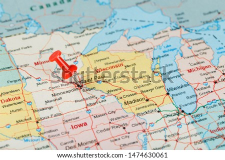 Red clerical needle on a map of USA, Minnesota and the capital Saint Paul. Close up map of Minnesota with red tack #1474630061
