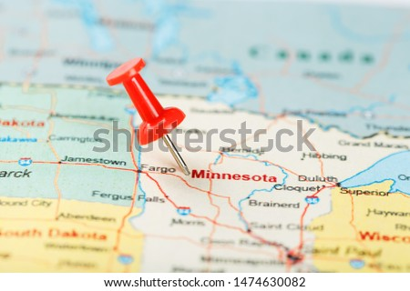 Red clerical needle on a map of USA, Minnesota and the capital Saint Paul. Close up map of Minnesota with red tack #1474630082