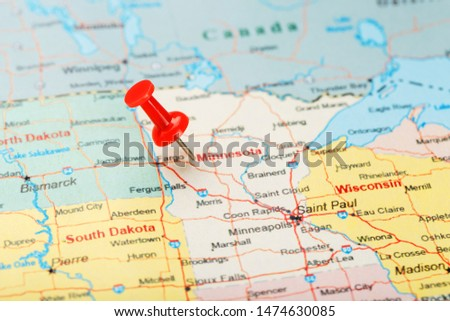 Red clerical needle on a map of USA, Minnesota and the capital Saint Paul. Close up map of Minnesota with red tack #1474630085