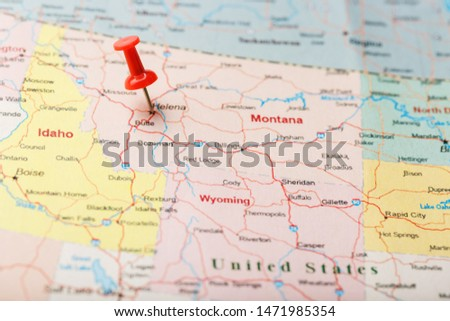 Red clerical needle on a map of USA, Montana and the capital of Helena. Close up Montana map with red tack #1471985354