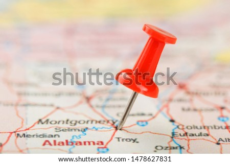 Red clerical needle on a map of USA, South Alabama and the capital Montgomery. Close up map of South Alabama with red tack #1478627831