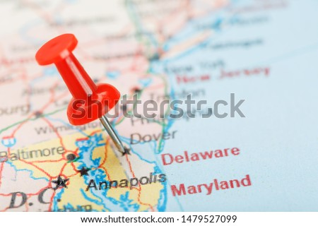 Red clerical needle on a map of USA, South Delaware and the capital Dover. Close up map of Delaware Carolina with red tack #1479527099