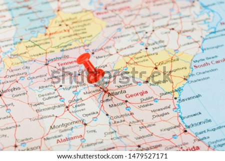 Red clerical needle on a map of USA, South Georgia U.S. state and the capital Atlanta. Close up map of South Georgia U.S. state with red tack #1479527171
