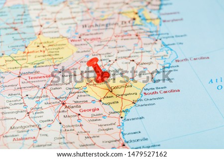 Red clerical needle on a map of USA, South South Carolina and the capital Columbia. Close up map of South South Carolina with red tack, United States map pin #1479527162