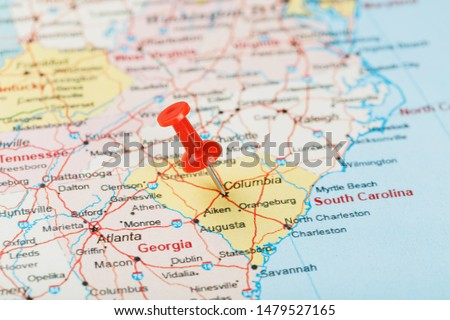 Red clerical needle on a map of USA, South South Carolina and the capital Columbia. Close up map of South South Carolina with red tack, United States map pin #1479527165