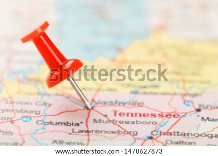 Red clerical needle on a map of USA, South Tennessee and the capital Nashville. Close up map of South Tennessee with red tack #1478627873