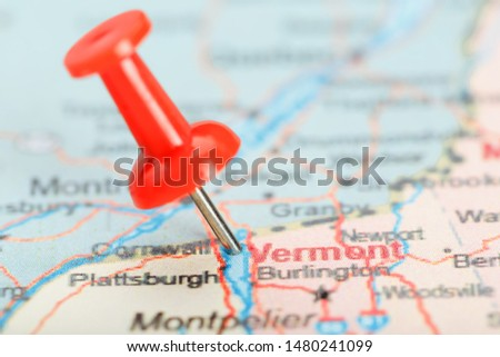 Red clerical needle on a map of USA, South Vermont and the capital Montpelier. Close up map of South Vermont with red tack #1480241099